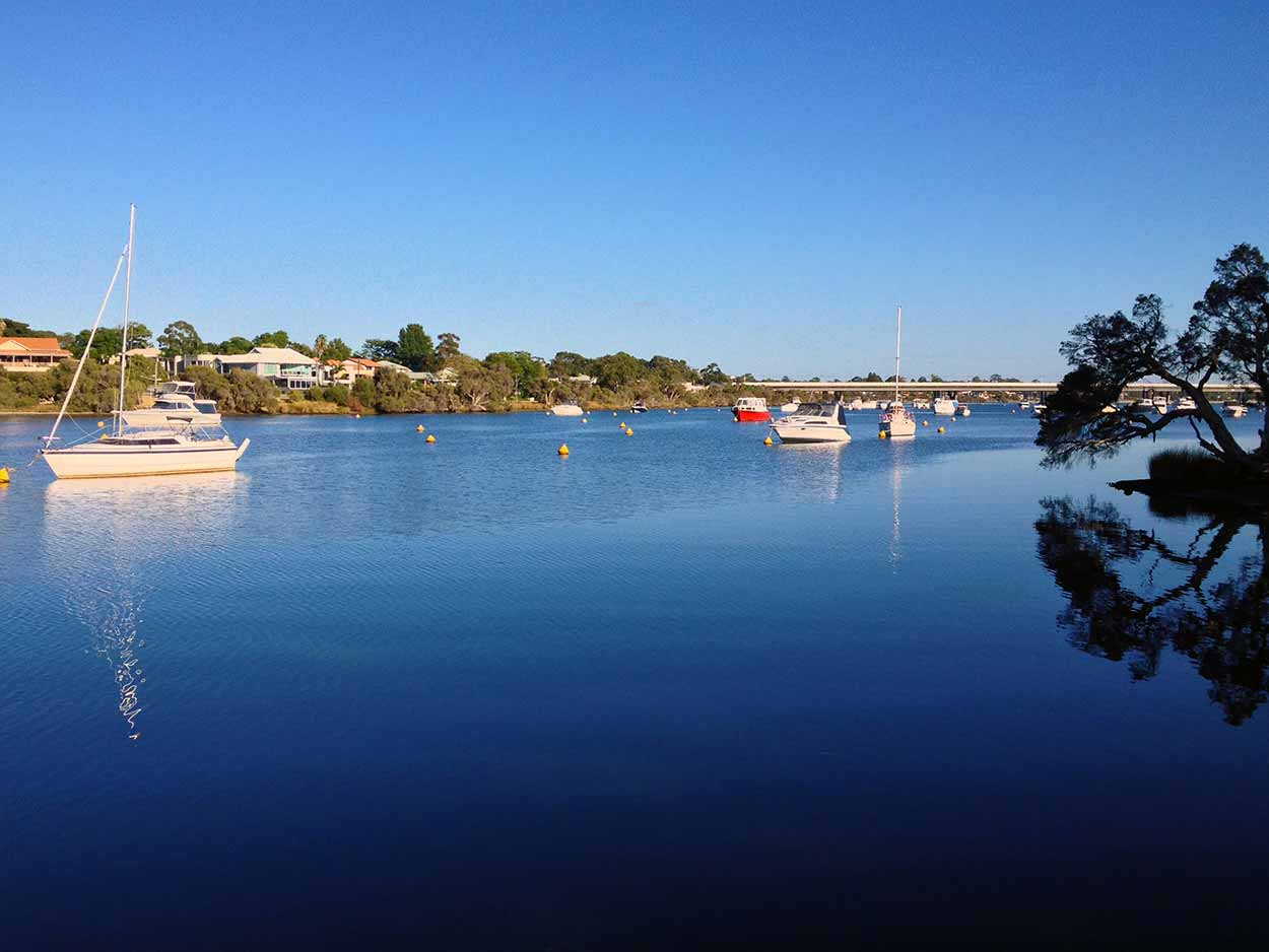 Yachts moored on Bull Creek as viewed from a small jetty near Riverton Drive, Canning River, Perth, Western Australia