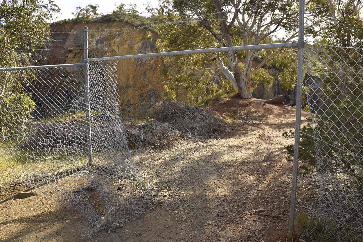 The broken fence to views over the Old Barrington Quarry, Ellis Brook Valley Reserve, Perth, Western Australia