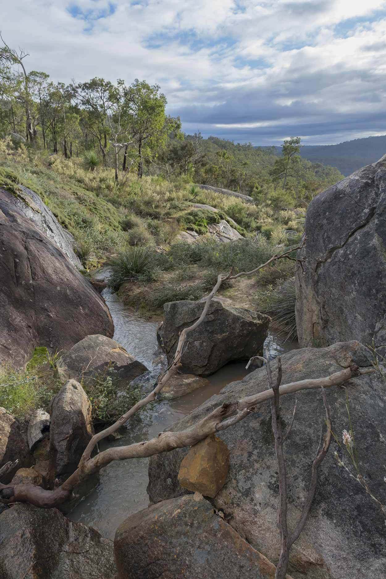 Water flowing towards Rocky Pool, Kalamunda National Park, Perth, Western Australia