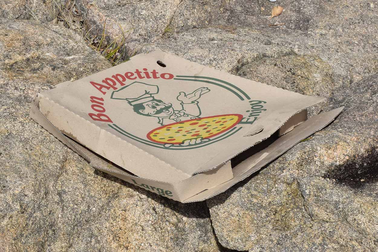 Pizza box on a rocky section of the Shoulder Trial, Mundy Regional Park, Perth, Western Australia