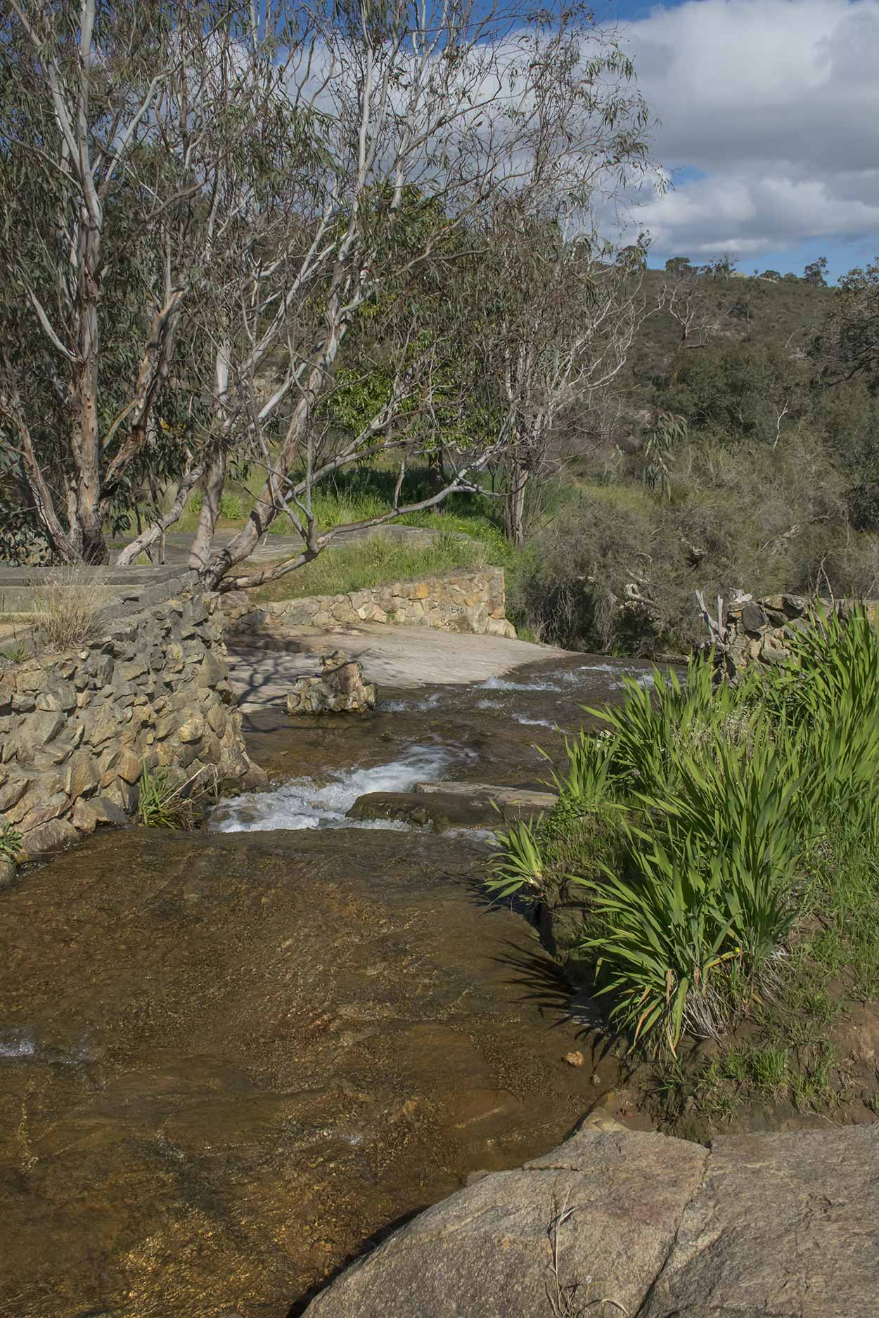 Foundations of a house which formally crossed the stream, Mundy Regional Park, Perth, Western Australia