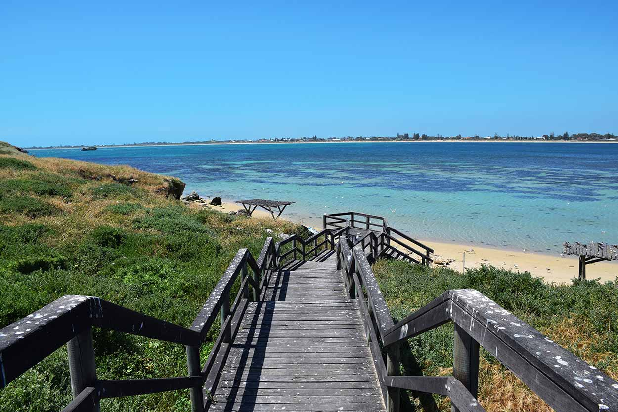 Boardwalk with a view over the blue waters of Shoalwater Bay, Penguin Island, Rockingham, Perth, Western Australia