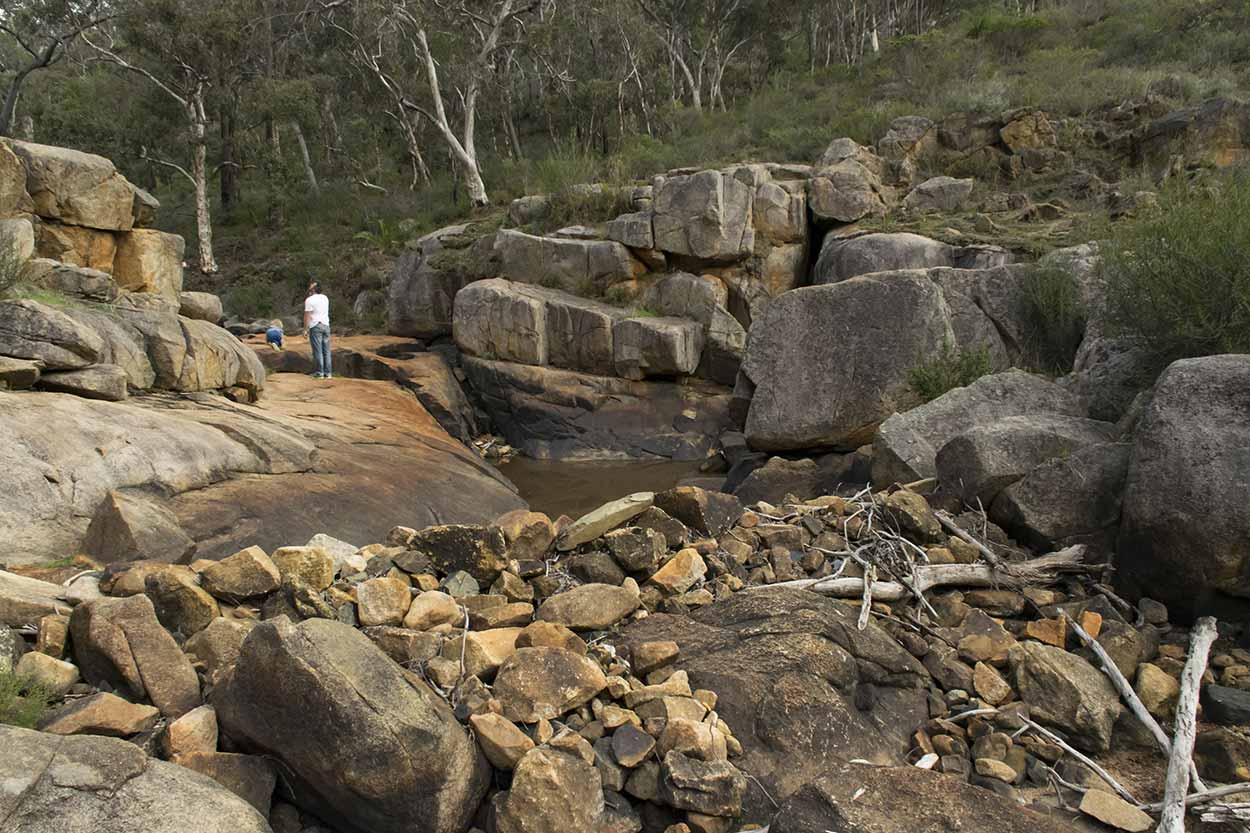 Walking around a dry Rocky Pool, Kalamunda National Park, Perth, Western Australia