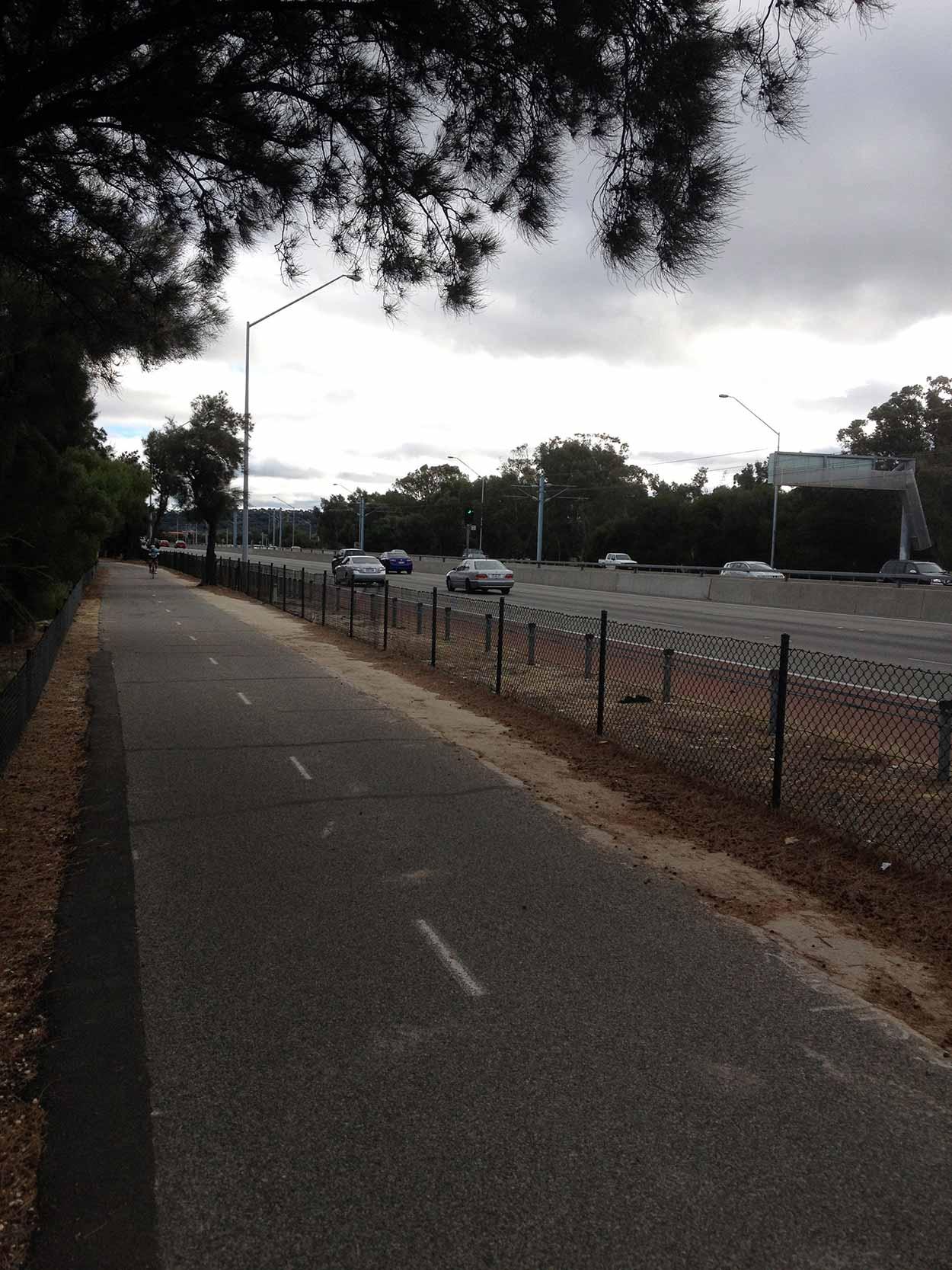 The six lane Kwinana Freeway with the Mandurah train line in the middle,  Perth, Western Australia