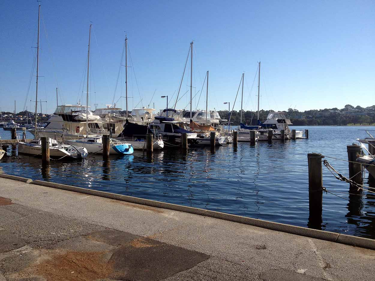 Boats moored on the Swan River at the East Fremantle Yacht Club, Perth, Western Australia