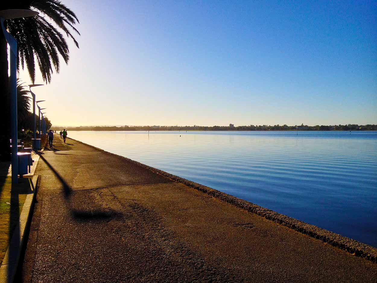 The calm waters of the Swan River from the Riverside Drive Path, Perth, Western Australia