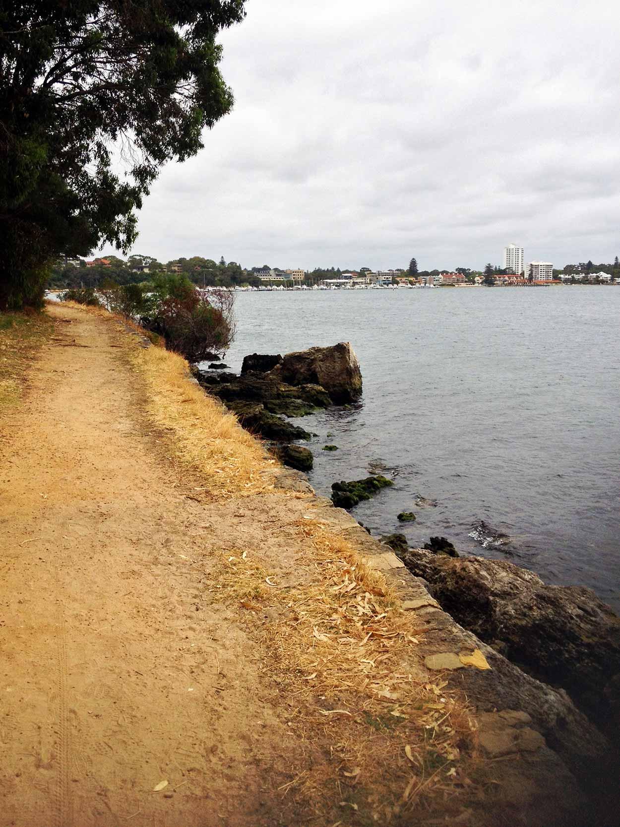 Strolling along a gravel path next to Karrakatta Bank, Swan River, Perth, Western Australia