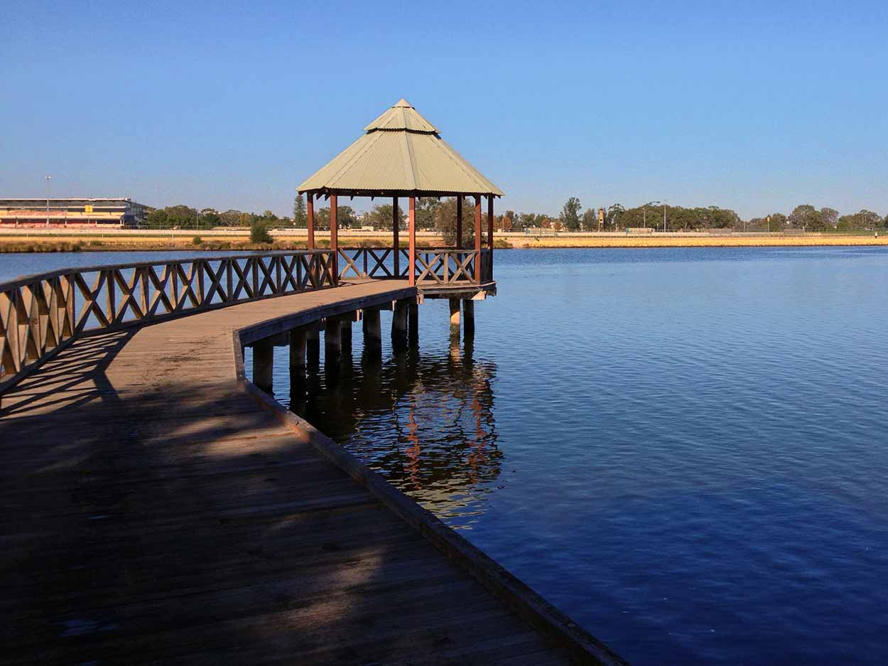 A jetty out to the Swan River from the Bayswater Riverside Gardens, Swan River, Perth, Western Australia