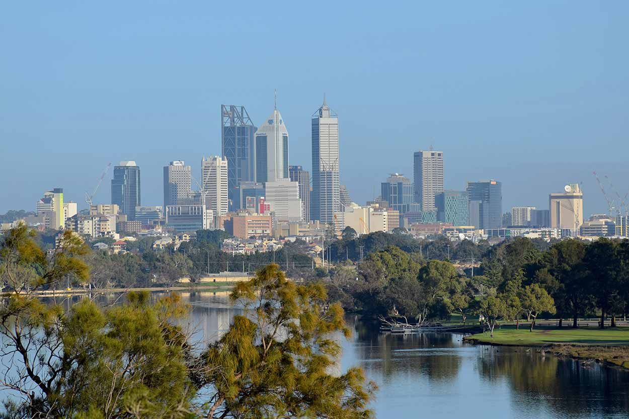 Perth CBD views in the distance from the Rivervale bank of the Swan River, Perth, Western Australia