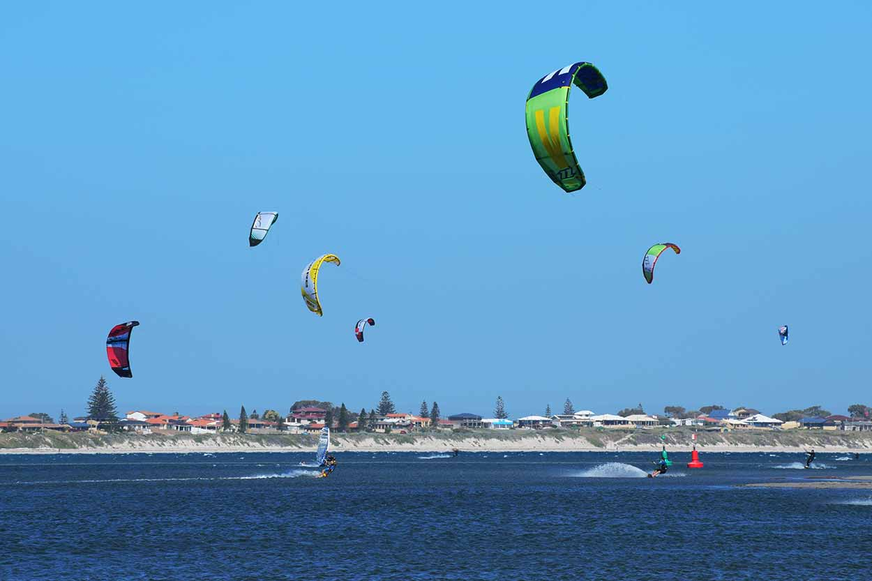 Kitesurfers enjoying the wind at The Pond, Safety Bay, Perth, Western Australia