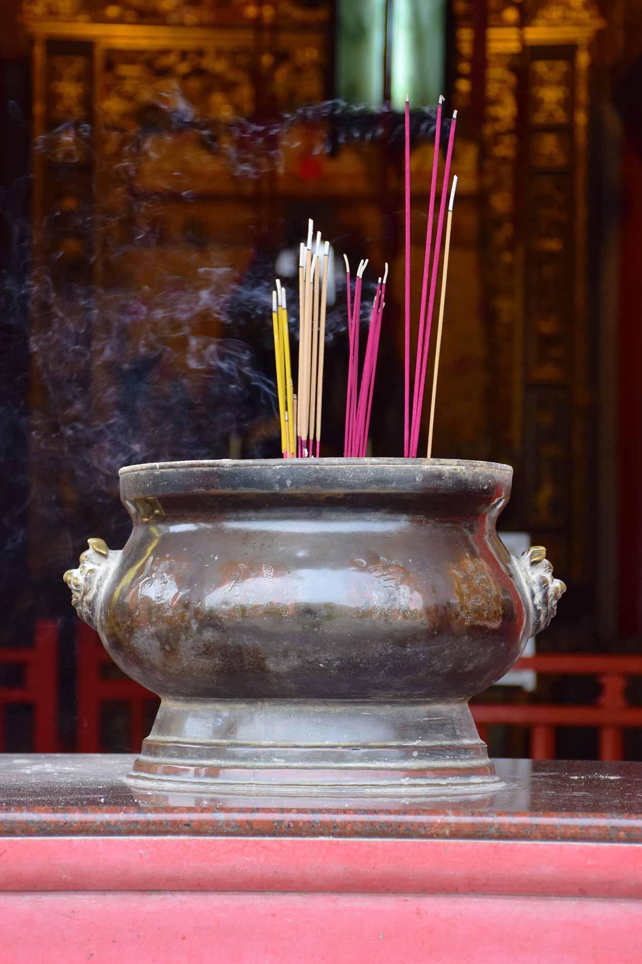 Incense burning at Fung Ying Seen Koon main temple, Fanling, Hong Kong, China