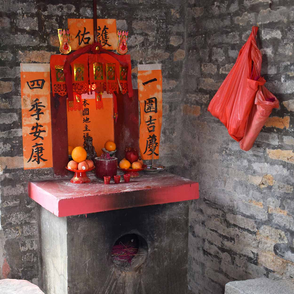Shrine to the Earth God within the Tung Kok Wai entrance tower, Lung Yeuk Tau Heritage Trail, Hong Kong, China