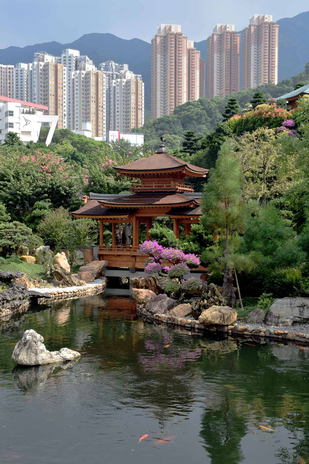 The view from the Lunar Reflection Terrace over the Blue Pond to the Pavilion Bridge, Nan Lian Garden, Hong Kong, China