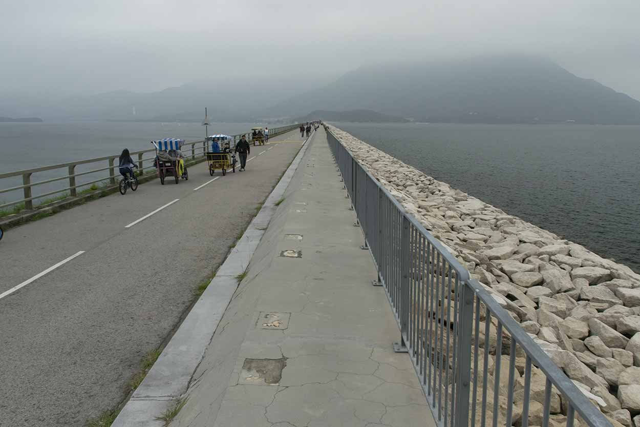 Walking along the main wall of the reservoir, Plover Cove Reservoir Country Trail, Hong Kong, China