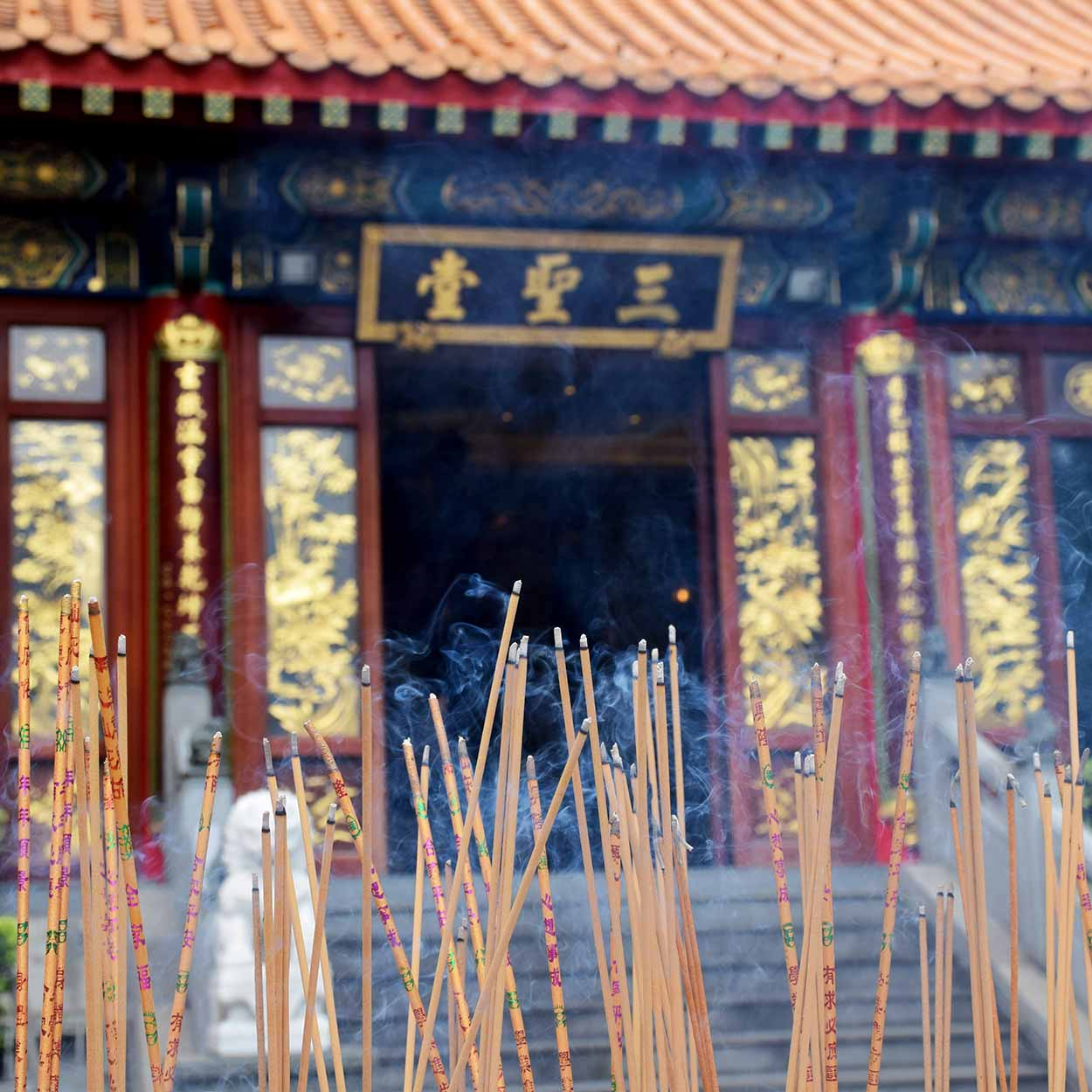 Incense smoke fills the air at the Three Saints Hall, Sik Sik Yuen Wong Tai Sin Temple, Hong Kong, China
