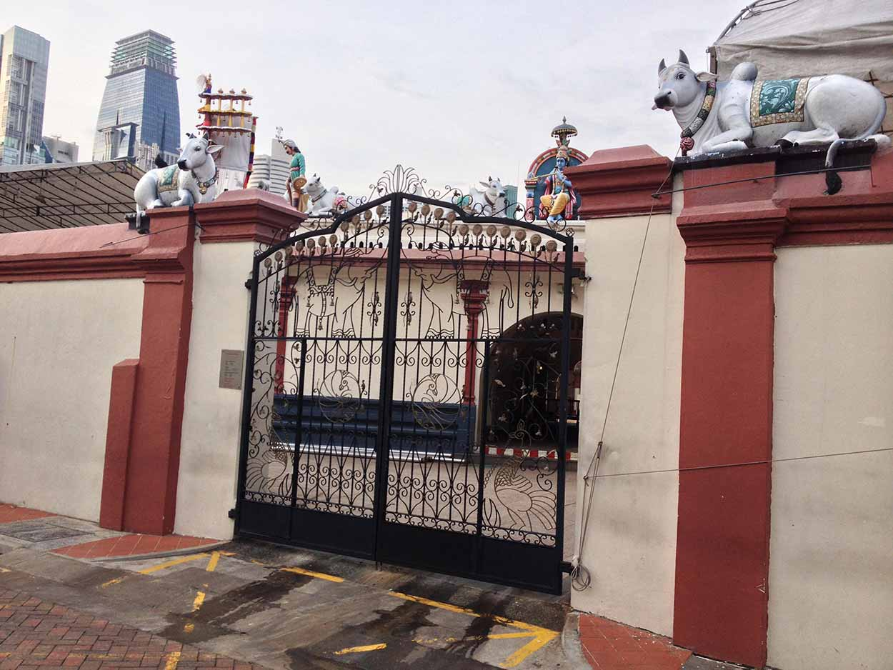 Some of the cow sculptures of the Sri Mariamman Temple viewed from Pagoda Street, Chinatown, Singapore