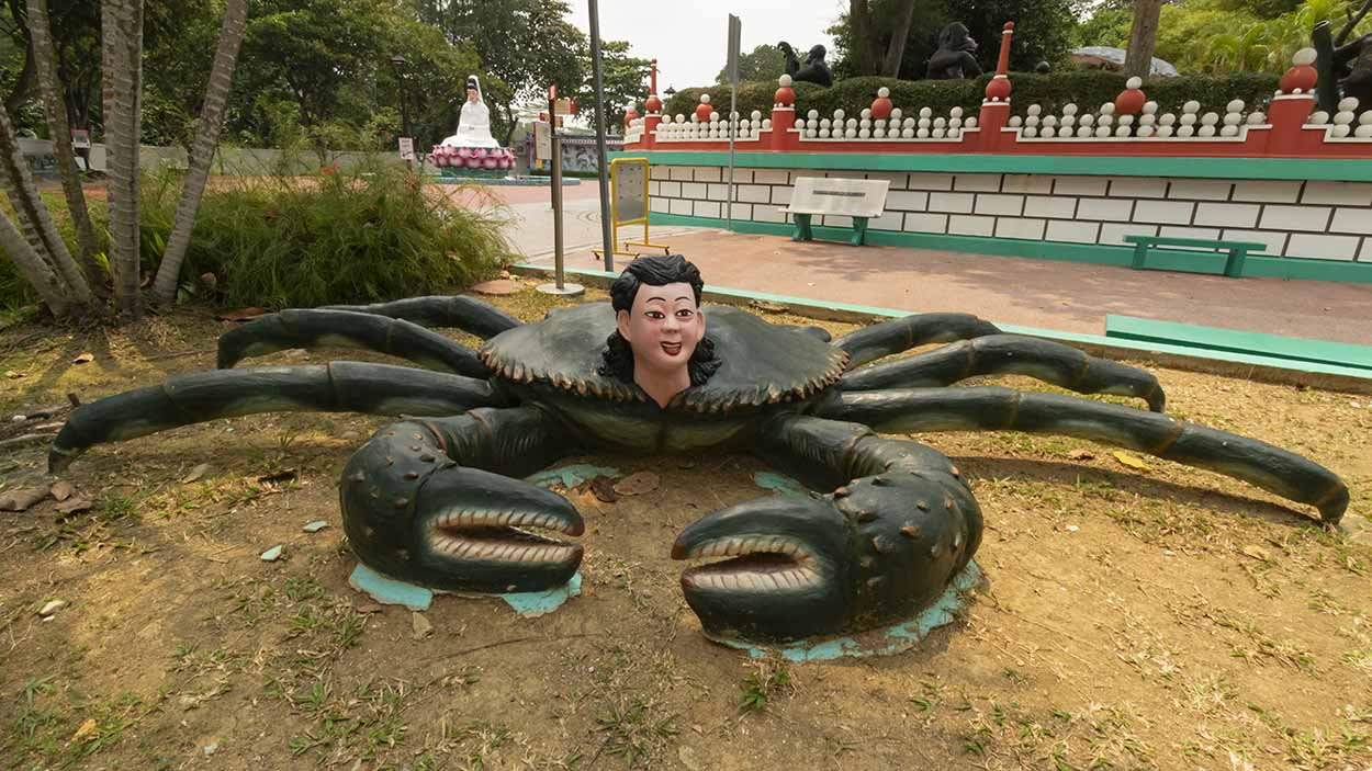 Crab woman at the Signature Pond, Haw Par Villa, Singapore