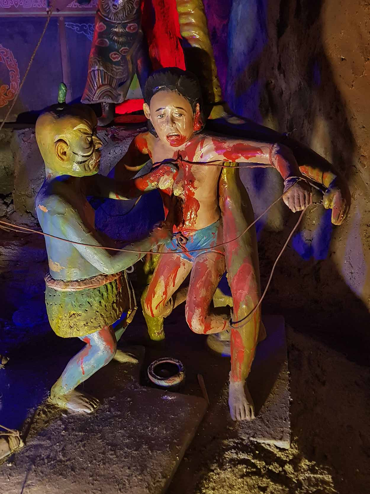 Sinners subjected to gruesome tortures within the Ten Courts of Hell, Haw Par Villa, Singapore